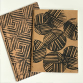 Hand-carved stamp printed kraft sketchbooks